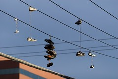 Photograph: Shoes on a wire 1