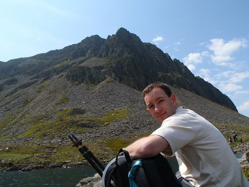 Sat, 2008-05-24 13:22 - Adam resting at the lakeshore of Llyn y Gadair, Wales before our scrambing up on Cyfrwy Arete (grade 3S or Diff), Cadair Idris, seen in the background.