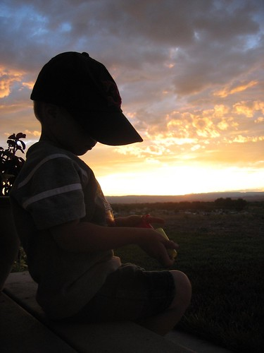 silhouette hat sunset kid brother porch child children boy clouds thinking cute