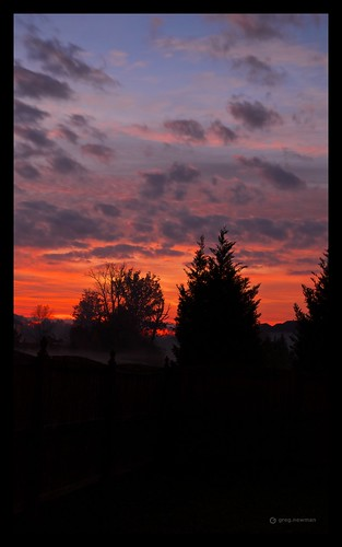 blue red orange contrast sunrise charlotte northcarolina clounds