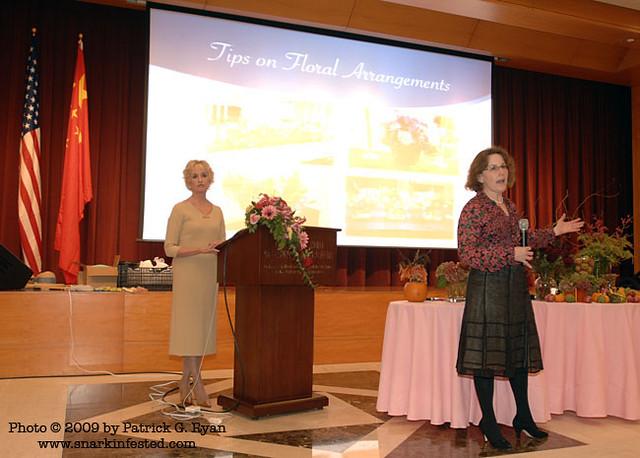 Coach Kemper and Susan Poneman discussing floral arrangeme… | Flickr