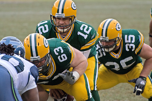 Scott Wells (63), Aaron Rodgers (12), Korey Hall (35) | by Mike Morbeck