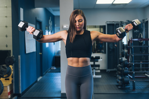 Fitness Model Shoulder Exercise Weight Training - Must link to https://thoroughlyreviewed.com | by ThoroughlyReviewed