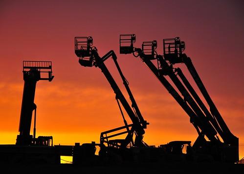 sunset sky industry silhouette sunrise easter boom christian genie goodfriday genieboom aerialworkplatform telehandler