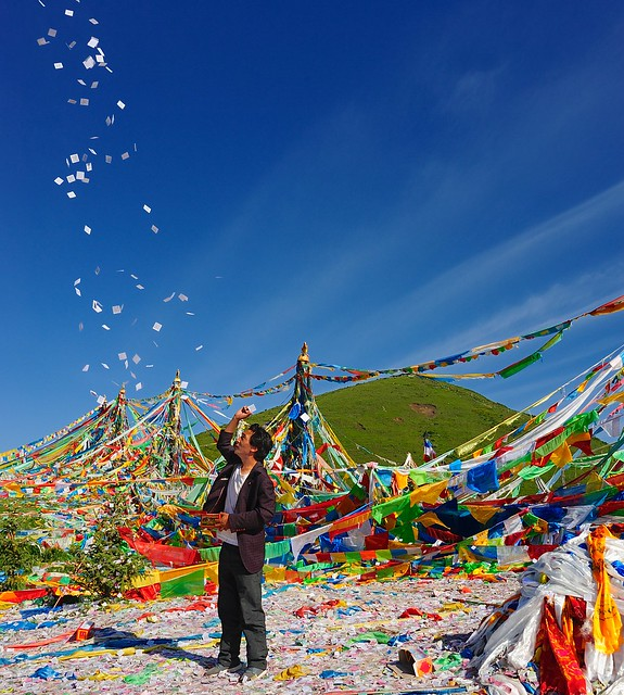 Throwing paper prayer flags, Tibet 2014