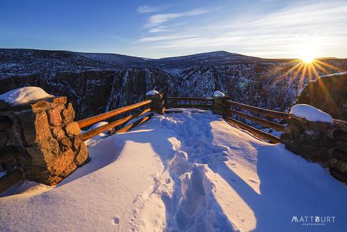 sunrise winter blackcanyon snow nationalpark sunrays sunburst fence railing overlook cliff canyon