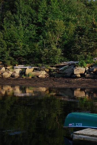 trees canada reflection water nationalpark dock rocks canoe newbrunswick kouchibougauc