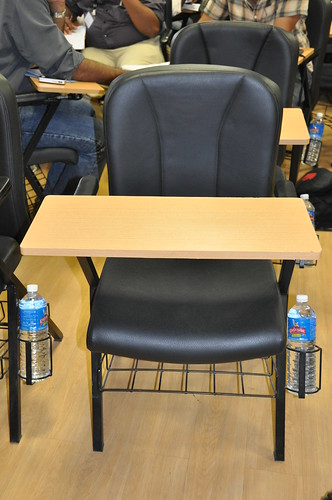 Chairs have bottle-holders | by Ernest W Adams