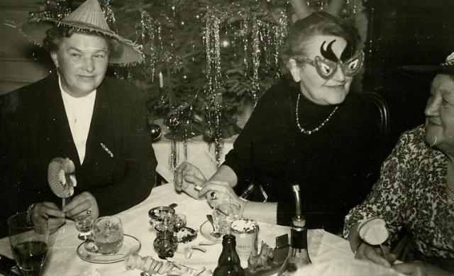 1950s Three Older Women In Mask and Funny Hats at Christmas Party Vintage photo