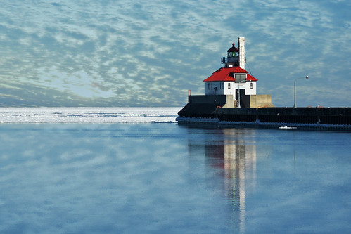 light lighthouse lake reflection ice water minnesota clouds america sunrise landscape harbor pier boat ship south ships superior greatlakes beacon mn duluth lakesuperior navigation canalpark duluthharbor southbreakwaterouterlighthouse southpierlighthouse southbreakwater bestofmywinners inlandseaport