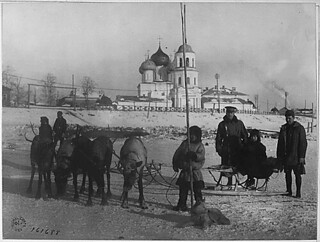 American officers frequently employed reindeer teams in crossing the Dwina River and in going about Archangel. Here are two officers with a team they have just engaged. A Russian young lady is also a passenger, 03/07/1919