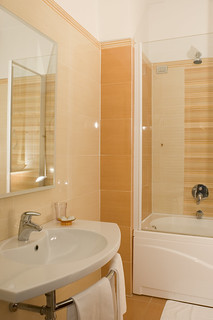 Bathroom with shower and thub