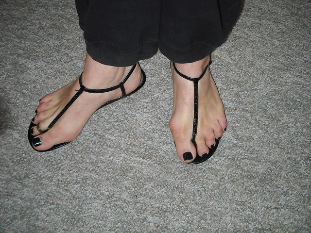 Black thong sandals with black nail polish