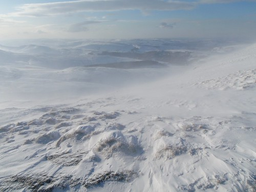 Sat, 2010-01-09 11:59 - In the midst of the prolonged cold spell once in 30 years.  Viewing South-west from somewhere near Kinder downfall.  The two triangle-shaped black patches are plantations.