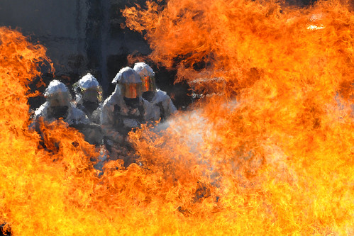 Florida and Virginia Guardsmen, firefighters extinguish a fire in a live-fire training simulator | by The National Guard