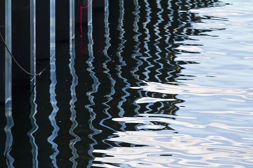 water sea ocean harbor reflection reflect dock pilings coast coastal seacoast winter offseason abstract saltwater blue pier wharf