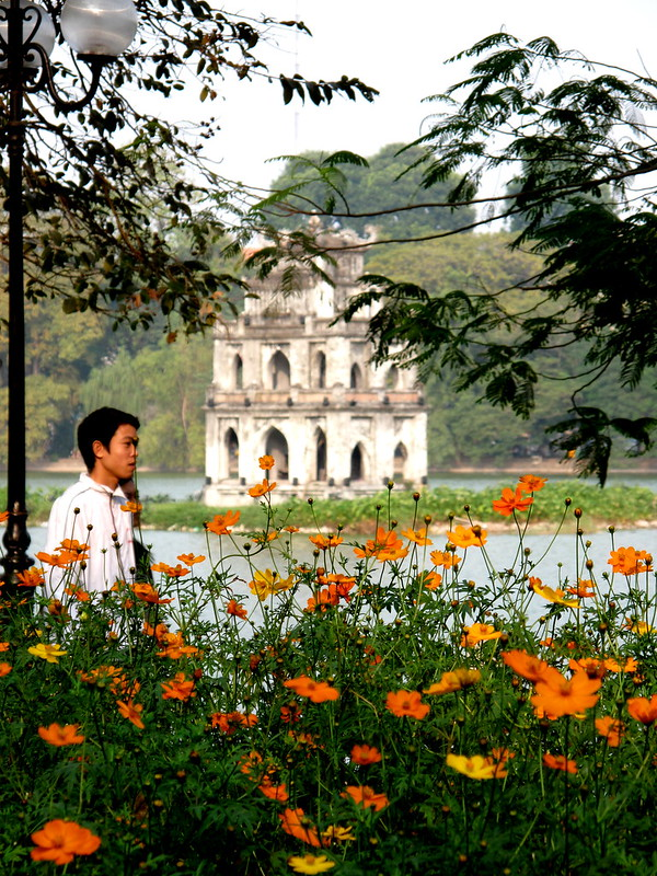 Pagoda in the lake with flowers