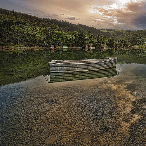sunset reflection bay boat nz dunedin aotearoa blueskin nopolariserjusttouchoftopaz