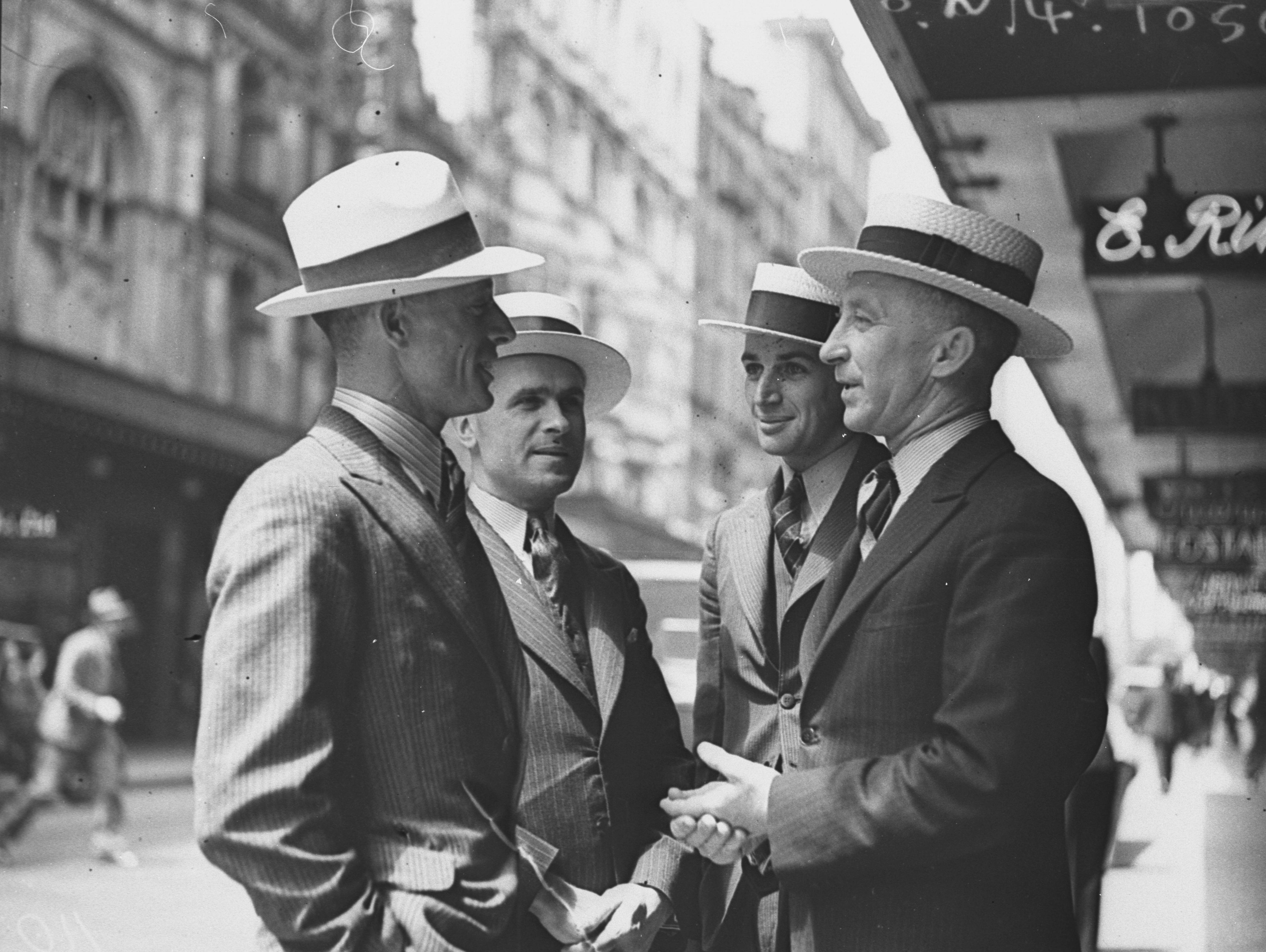 Four men modelling hats in Pitt Street