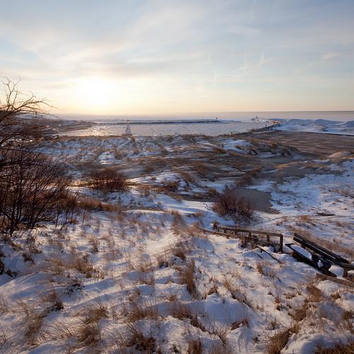 winter sunset lighthouse snow beach harbor shadows sundown michigan dunes lakemichigan newbuffalo img99656 onedozenplaces