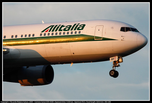 italy rome roma plane sunrise reflections dawn airport body aviation tail wide wing jet engine landing takeoff airliner liner fuselage