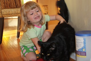 """Catie: """"C'mon, Beaumont, we take a pitcha!"""" Beaumont: """"Get this kid away from me, I just want my kibble.""""   by poobou"""