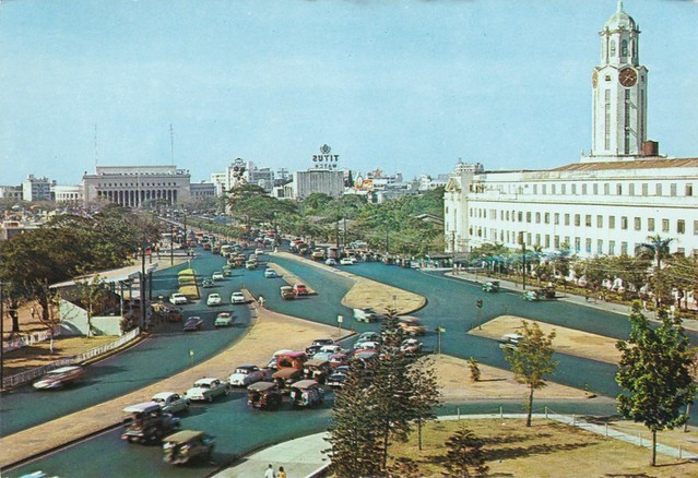 Manila, Philippines late 1950s. Post Office in distance, Manila City Hall on the right