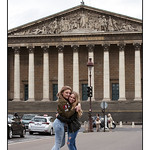 Sisters Hugging Before the Lower House of the French Parliament