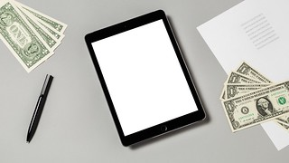 Tablet and money (white background) | by cafecredit