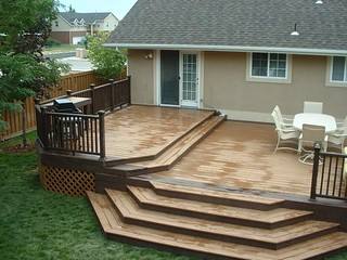 Trex Woodland Brown and Saddle Deck with Woodland Brown Designer Railing | by CFC Fences & Decks