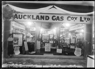 Stall at a trade fair advertising the Auckland Gas Company, 1930   by National Library NZ on The Commons