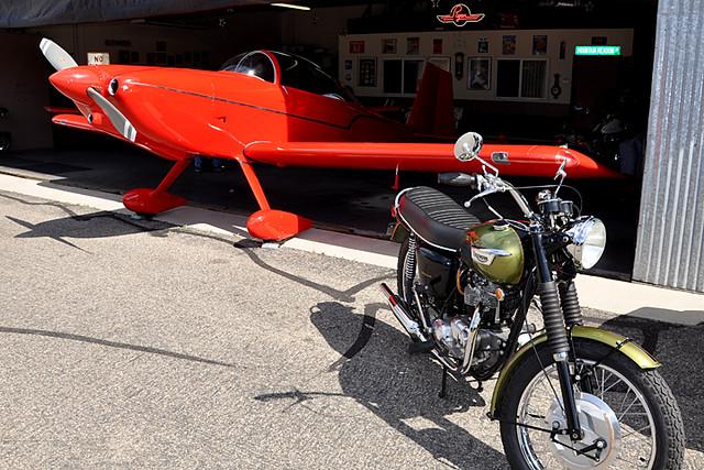 plane and vintage Triumph