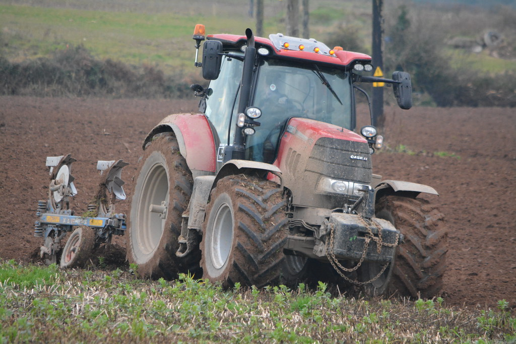 Case IH Puma 175 CVX Tractor with a Lelken 4 Furrow Plough