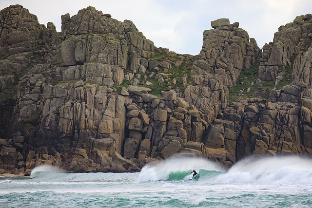 Surfer at Logan Rock, Porthcurno