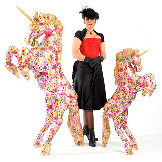 Suzanne with two of her unicorn sculptures | by artofhappiness