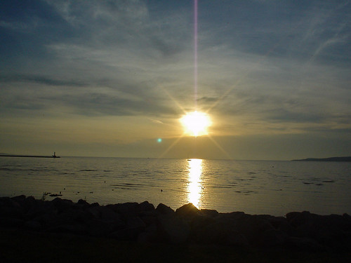 sunset sun lake water bay michigan lakemichigan cirrus petoskey littletraversebay