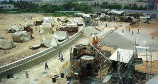construction workers temporary residences on top of ruins of water tank