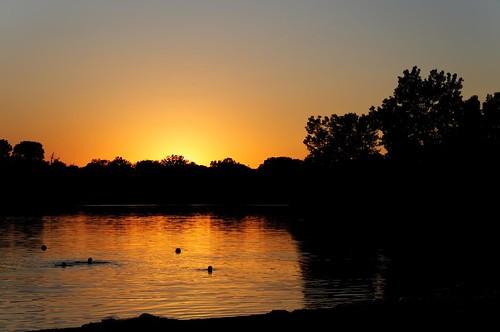 sunset summer sun lake nature train swimming wagon landscape pond nebraska cliche worldland