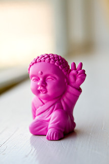 "Pocket Buddha Says, ""Peace."" 