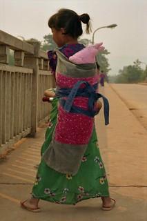 Young Dai girl carrying baby; NE of Mengla, Xishuangbanna Region, Yunnan, China | by Lon&Queta