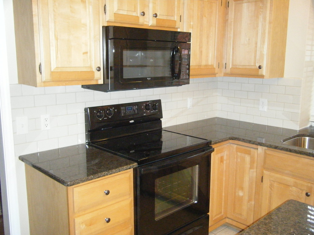- Tropic Brown Granite Countertop With Tile Backsplash Flickr
