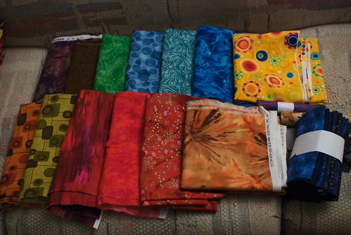 While Jacob was here for New Year's weekend 2009/2010, we took advantage of a sale at Patches and Stitches. I gave him carte blanche, and asked him to pick fabrics he liked. These are his choices.  See the entry on my site:  domesticat.net/2010/01/previews-2010-new-years-fabric