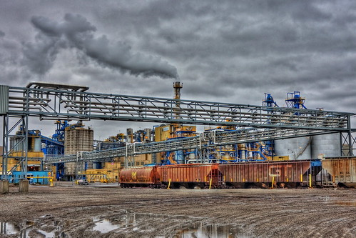 cloud plant ontario canada canon grit puddle eos factory fb smoke grunge transport hamilton tracks rail dirt smokestack processing dslr hdr railroadcars bunge steeltown photomatix burlingtonstreet 40d industrialroad canon40d canonefs1855mm13556is industrialsector