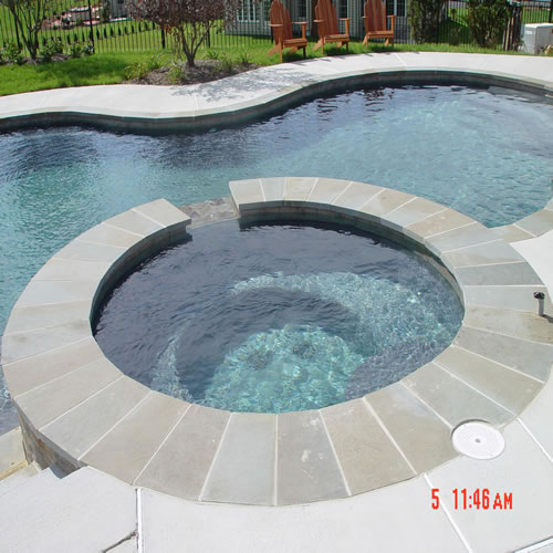 Custom maryland pool with dark interior finish and natural ...