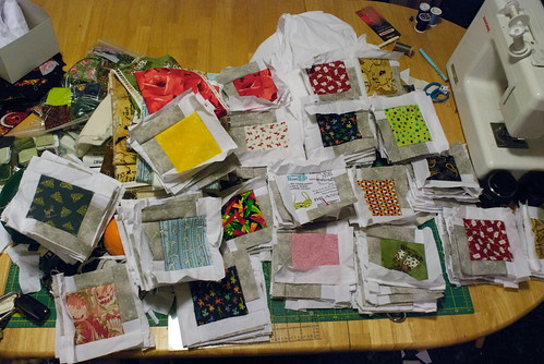 The pieces of the Red Librarian quilt, sorted by fabric and ready to sew
