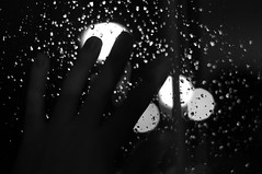 hand on rainy window