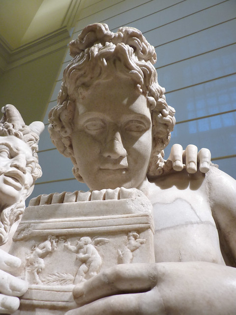 Pan teaching a youth playing the panpipe or syrinx