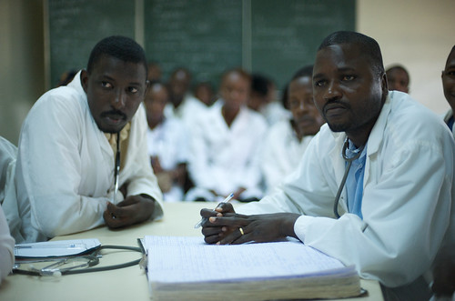 Pediatric doctors at Donka hospital reviewing mealses cases | by Julien Harneis