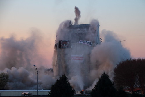 demolition implosion ga georgia building dust sunrise blue sky