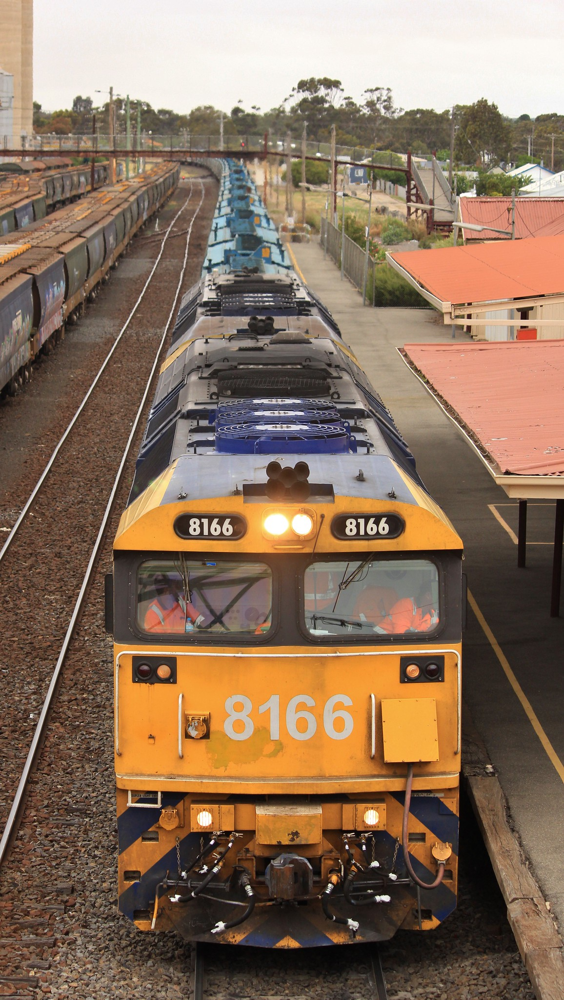 8166 and 8123 waits for extra crew to jump aboard for the trip to grain flow by bukk05